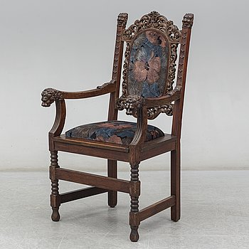 A Baroque style oak armchair, first half of the 20th Century.