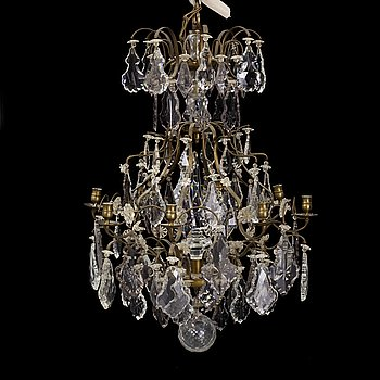 A Rococo-style eight-light chandelier, early 20th century.