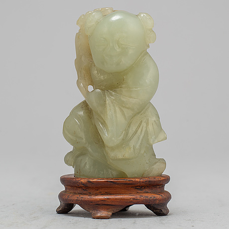 A nephrite sculpture of a figure, qing dynasty, 19th century