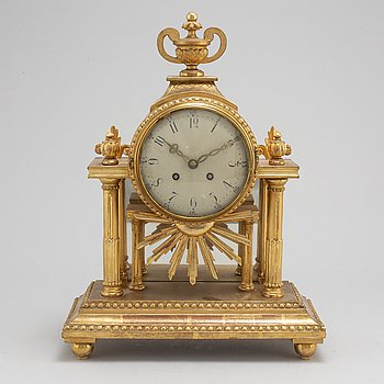 A Gustavian style mantle clock, signed C.A. Carlsson 12/12 1913 Nyköping.