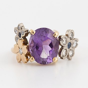 Oval faceted amethyst, brilliant-cut diamond and sapphire flower ring.