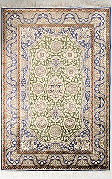 A silk rug, on cotton. 184 x 124 cm.