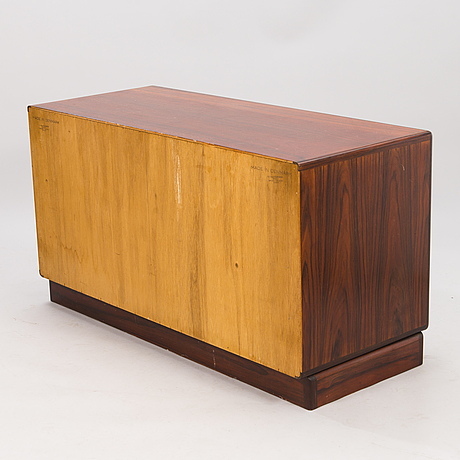 A rosewood veneered sideboard/commode by h.p hansen furniture maker, denmark 1950/60:s.