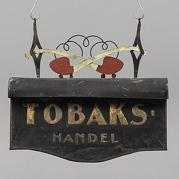 A painted tin shop sign, early 20th Century.