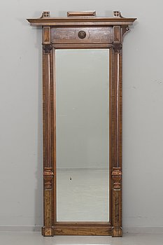 An early 20th century empire style mirror.