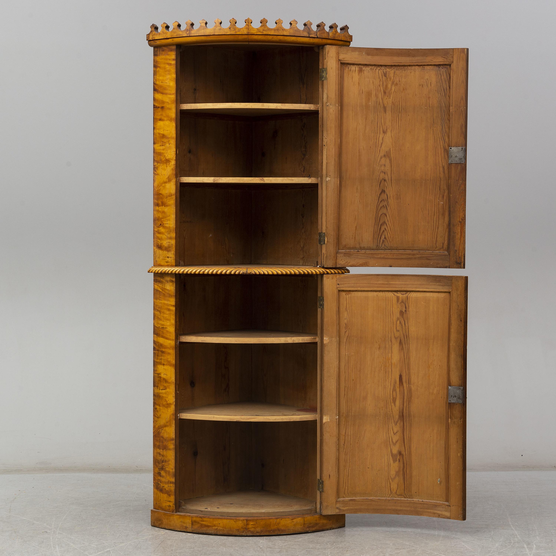 A Swedish Mid 19th Century Corner Cabinet Bukowskis