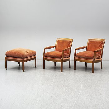 KERSTIN HÖRLIN-HOLMQUIST, a pair of 'Ofelia' armchairs with one foot stool, late 20th Century.