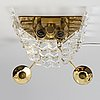 Carl fagerlund, a pair of brass and glass wall sconces from orrefors