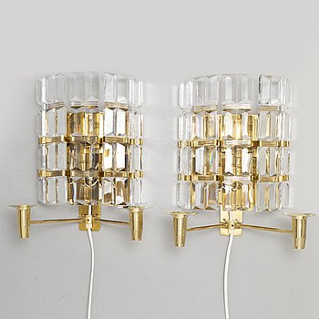 CARL FAGERLUND, a pair of brass and glass wall sconces from Orrefors.