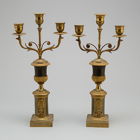 A pair of empire bronze candelabra, first half of the 19th century