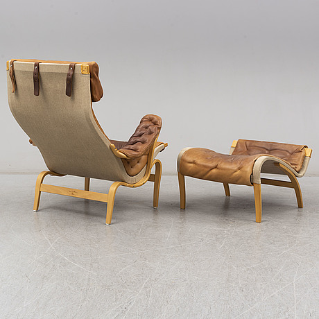 Bruno mathsson, a 'pernilla' beech easy chair and ottoman from dux