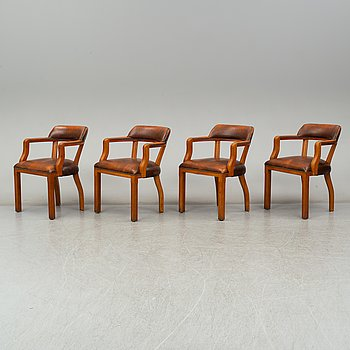 A set of four late 20th century English armchairs.