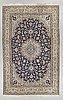 A carpet, nain, around 319 x 202 cm.