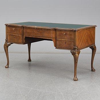 A Rococo-style circa 1900 writing desk.