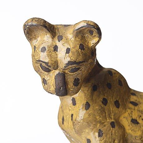 Vicke lindstrand, a ceramic sculpture of a cheetah, upsala-ekeby, sweden, model 3003.