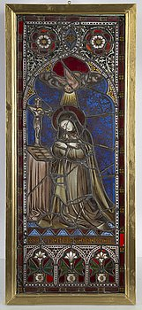 A stained glass window with St Theresa, late 19th Century.