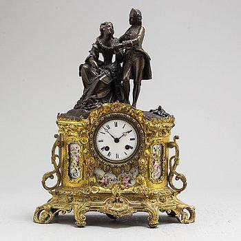 A Rococo style mantle clock, circa 1900.