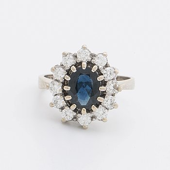 SAPPHIRE RING 18K whitegold 1 sapphire 1,59 ct and brilliant-cut diamonds 0,66 ct in total engraved.