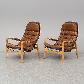 A pair of 1970's 'Mona' armchairs by Sam Larsson for Dux.