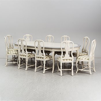 One dinner table and ten chairs, Rococo-style, modern production.