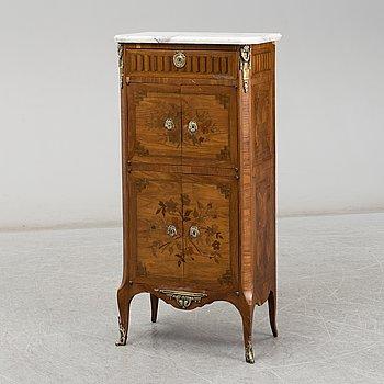 A 20th century Louis XVI-style cupboard.
