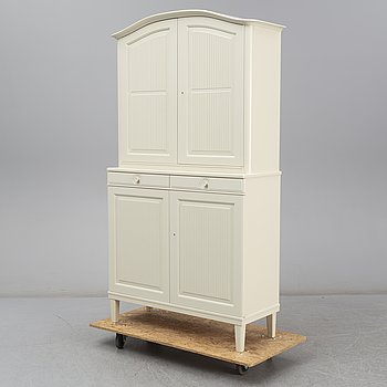 A 'Herrgården' cabinet by Carl Malmsten, for Åfors möbelfabrik.