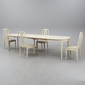 A Carl Malmsten dining table and four chairs. Three leaves included.