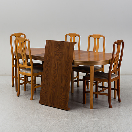 A dinner table with five chairs, late 20th century