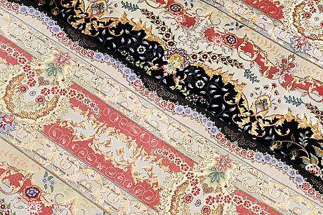 A carpet, oriental possibly tabriz part silk , so called 60 radj  310 x 250  cm