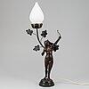 A spelter art nouveau sculpture, circa 1900. later altered into a table light.