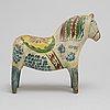 A dala horse, painted pine, circa 1900.