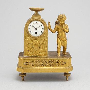 A German Empire mantel clock, early 19th century.
