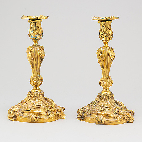 A pair of gilt bronze rococo style candlesticks, 19th century
