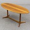 A 1959 'plommonet' walnut coffee table by kerstin hörlin-holmquist for nordiska kompaniet.