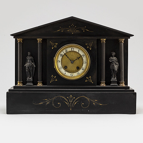 A french stone mantle clock, circa 1900.