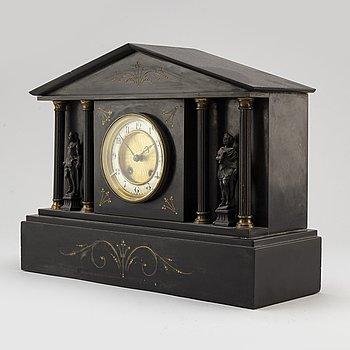 A French stone mantle clock, circa 1900.