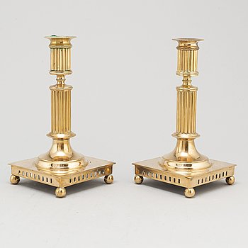A pair of brass candlesticks, first half of the 20th Century.