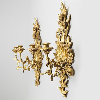 A pair of 20th century Rococo style wall lights.