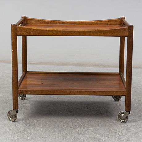 A signed tea trolley by hans j wegner for andreas tuck, denmark, mid 20th century.