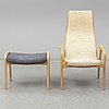 A 'lamino' armchair with a stool by yngve ekström for swedese.