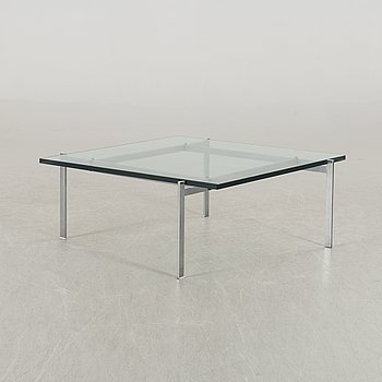 A Poul Kjaerholm PK61 glass table by Fritz Hansen.