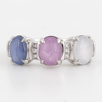 Multicoloured cabochon-cut star sapphire and princess-cut diamond ring.