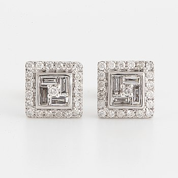 Brilliant-cut and baguette cut diamond earrings.
