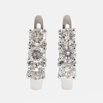 Brilliant-cut diamond earrings.
