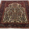 A rug, semi antique esfahan, around 213 x 140 cm