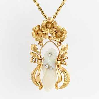 A Siegfried Egger design necklace with carved opal and brilliant-cut diamonds.