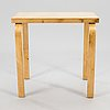 "Alvar aalto, an early 1930s side table, marked ""aalto design made in finland""."