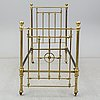 A late 19th or early 20th century bedframe
