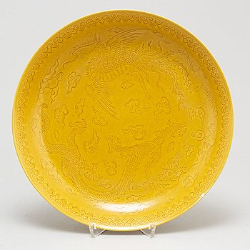 A Chinese yellow-glazed dish, 20th century.