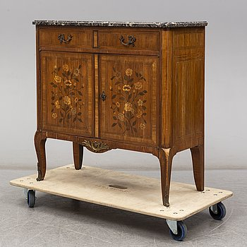 A French Louis XVI-style cupboard, ca 1900.